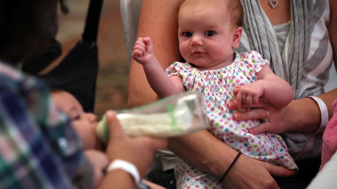 "SPRINGFIELD, VA - AUGUST 21:  Eight-week-old Eleanor Delp attends a ""What to Expect"" baby shower with her mother August 21, 2012 in Springfield, Virginia. The DC Metro Chapter of Operation Homefront held the event, with parenting and pregnancy workshops, to celebrate with 100 new and expecting military mothers representing each branch of service from DC, Maryland and Northern Virginia.  (Photo by Alex Wong/Getty Images)"
