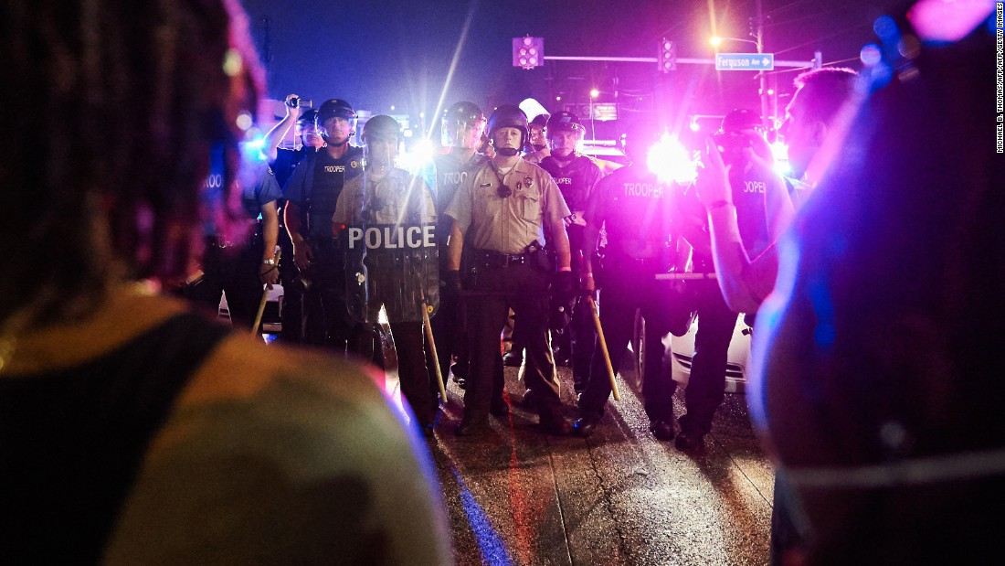 Police face off with demonstrators in Ferguson on August 9.