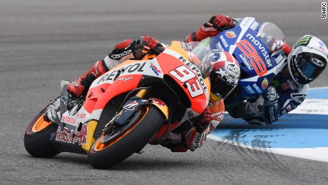 Reigning world champion Marc Marquez takes the lead from compatriot Jorge Lorenzo