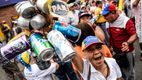 Activists of Venezuela's opposition hold a peaceful rally against crime and shortages in the country, in Caracas, on 8 August, 2015. With Venezuela's economy in recession, oil revenues plunging, crime soaring and consumers facing chronic shortages of basic goods, President Nicolas Maduro's approval rating has sunk in recent months. The rally comes four months from legislative polls the ruling party risks losing for the first time since late leftist leader Hugo Chavez came to power in 1999.  AFP PHOTO / FEDERICO PARRA        (Photo credit should read FEDERICO PARRA/AFP/Getty Images)