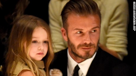 "LOS ANGELES, CA - APRIL 16:  Harper Beckham (L) and David Beckham attend the Burberry ""London in Los Angeles"" event at Griffith Observatory on April 16, 2015 in Los Angeles, California.  (Photo by Jeff Vespa/Getty Images for Burberry)"