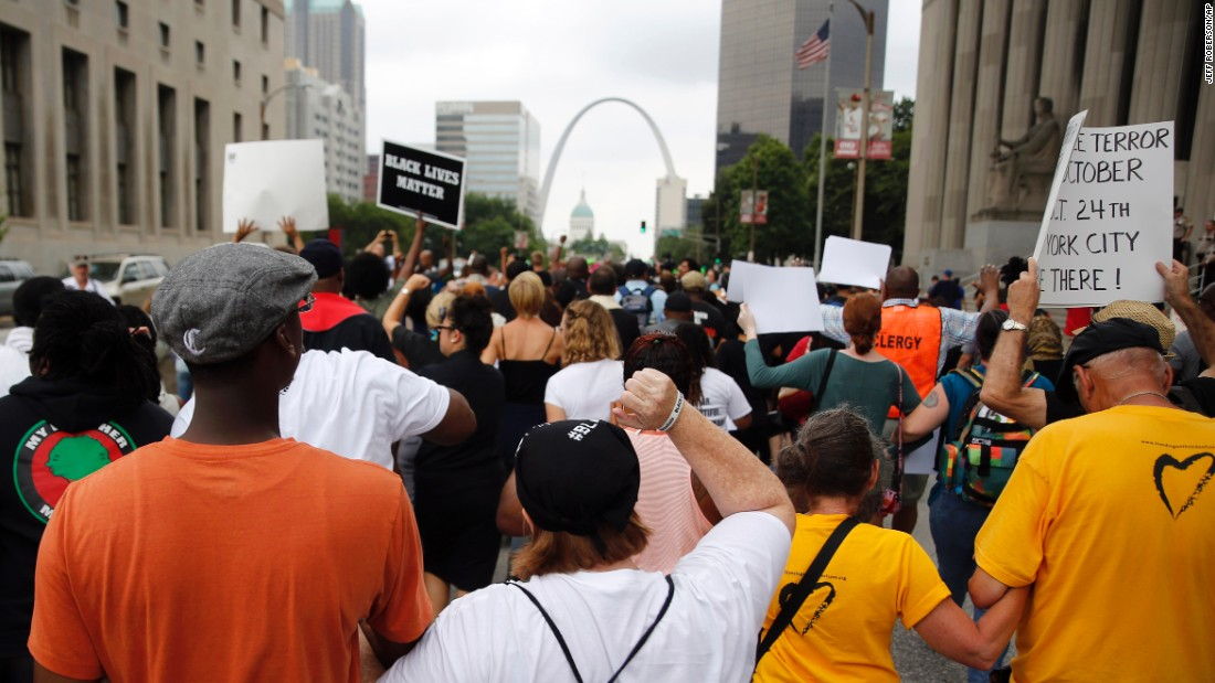 Protesters march to the Federal Courthouse on August 10 in St. Louis.