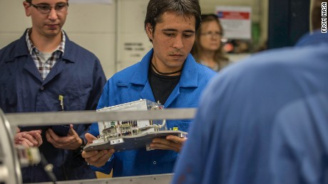 The Colorado Space ‎Grant Consortium's Jesse Austin oversees Marcus Yamaguchi on an experiment.
