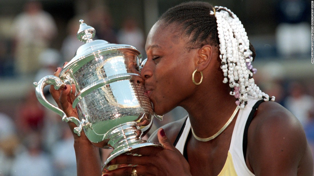 Serena sports a beaded hairstyle as she celebrates her first U.S. Open title -- and her first major -- back in 1999.