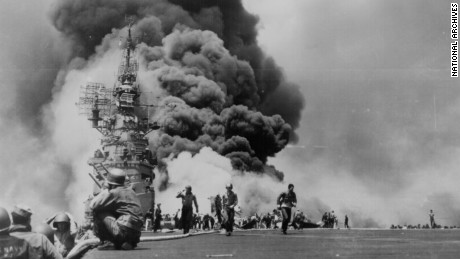 Smoke billows above the stricken USS Bunker Hill which was hit by two Kamikazes in 30 seconds on 11 May 1945 off Kyushu. General Photographic File of the Department of Navy.