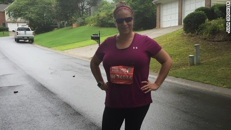Julia Smookler shows off her number after the Peachtree Road Race on July 4.