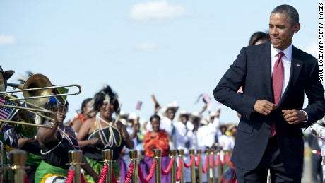 President Obama dances upon arrival in Dar Es Salaam, Tanzania, in 2013.