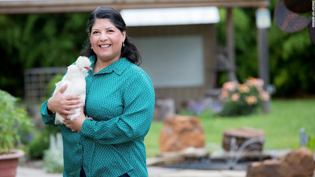 Margie Hernandez, principal of Pershing Elementary School in Dallas, Texas, holds one of the school garden's resident chickens.