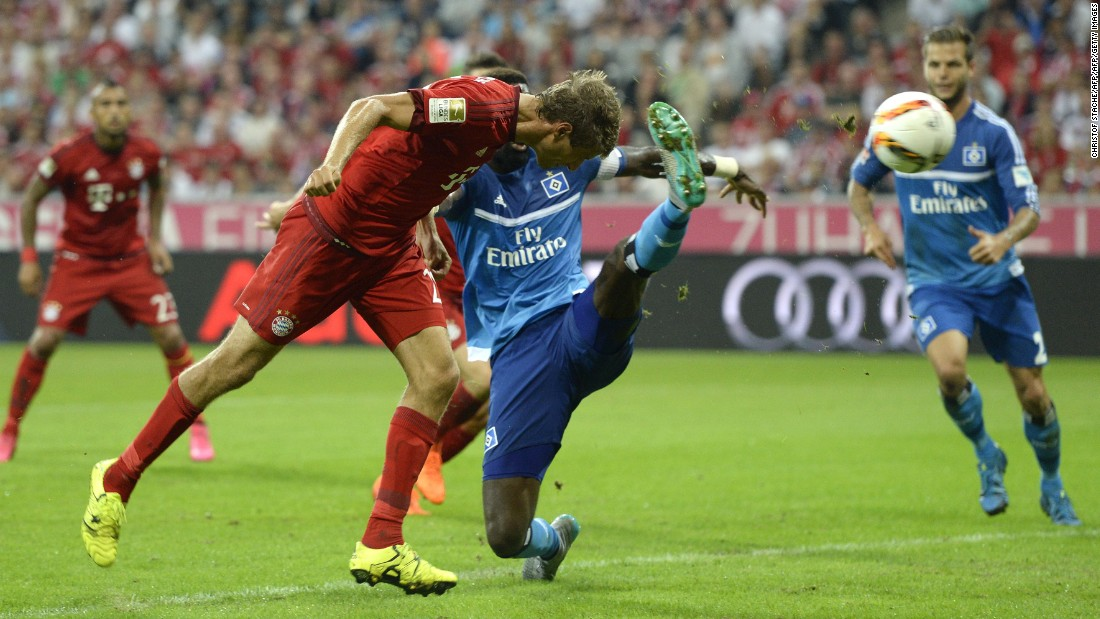 Bayern Munich demolished Hamburg 5-0 in the first game of its Bundesliga title defense. Here Thomas Muller heads the first of his two second-half goals, which came in the space of four minutes at the Allianz Arena.