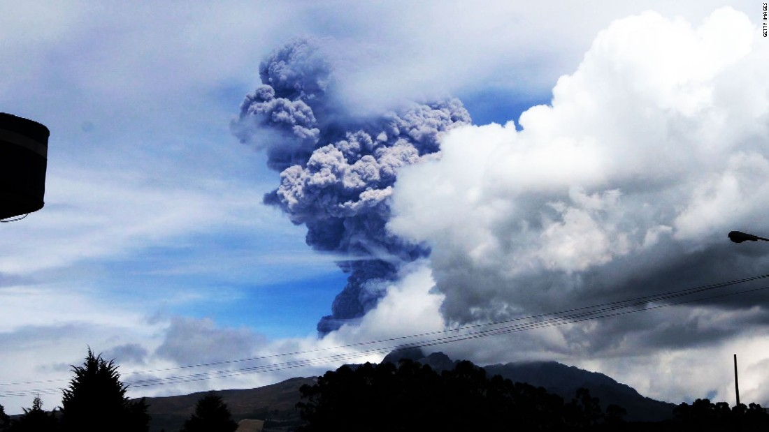 "Cotopaxi, a volcano in Ecuador, sends large gray puffs of ash into the sky on August 14, 2015. Officials <a href=""http://www.cnn.com/2015/08/15/americas/ecuador-japan-volcanoes/index.html"">declared a yellow alert</a>, the lowest level."