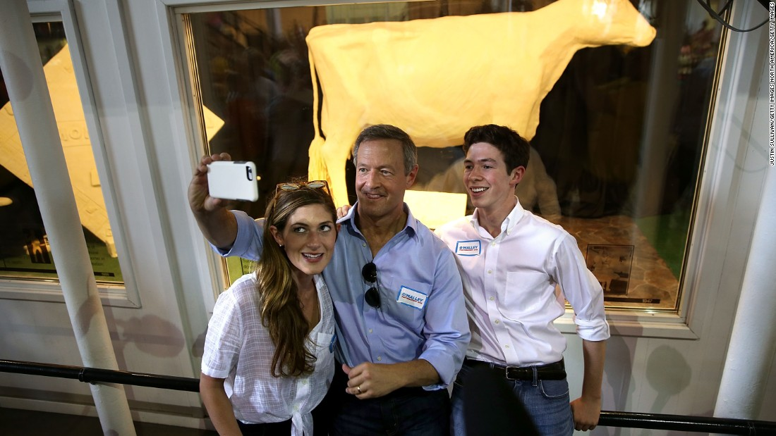 O'Malley takes a selfie in front of the butter cow with his children Grace and William on August 13.