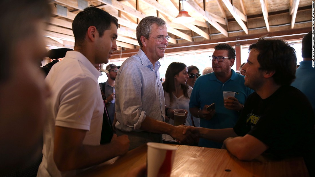 Bush meets fairgoers on August 14.