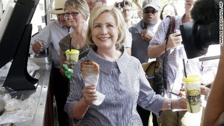 Democratic presidential candidate Hillary Rodham Clinton leaves a pork chop stand during a visit to the Iowa State Fair, Saturday, Aug. 15, 2015, in Des Moines, Iowa. (AP Photo/Charlie Neibergall)