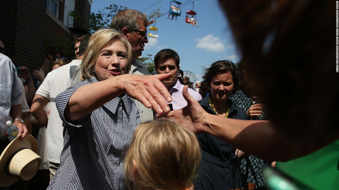 Clinton greets fairgoers on August 15.