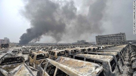Damaged cars explode and trigger new blasts at the site of explosion in Tianjin, China, on Saturday August 15.