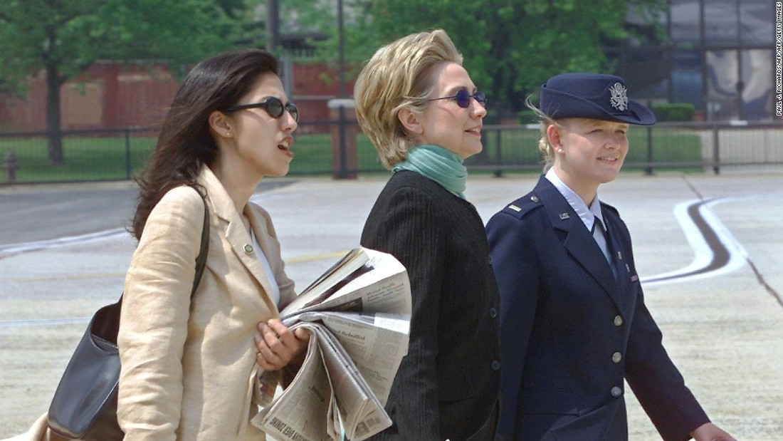 Abedin walks with Clinton at Andrews Air Force Base in 2000 as the Clintons prepared to leave for a wedding in Arkansas.