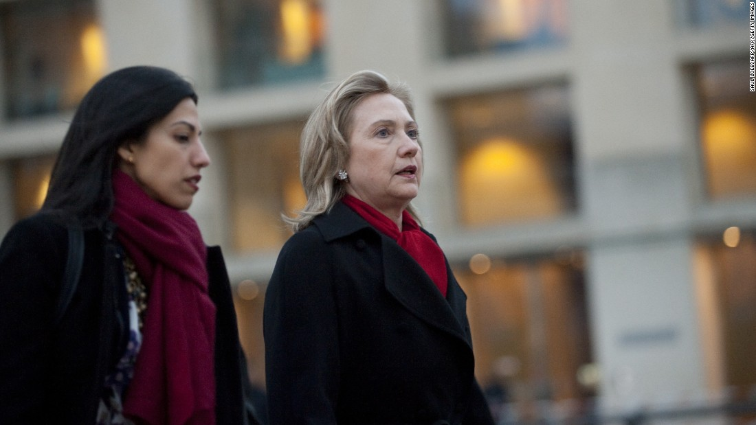 Clinton (right) and Abedin arrive for a NATO Foreign Minister family photo in front of the Brandenburg Gate in Berlin April 14, 2011.