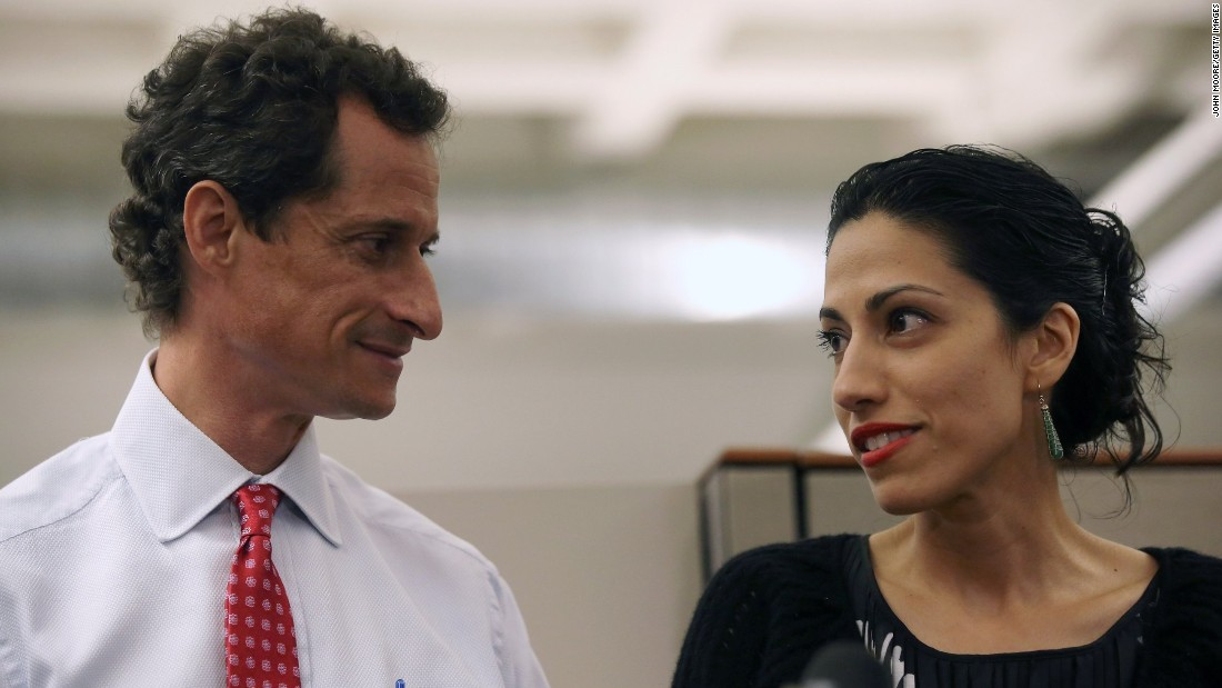Abedin stands with her husband, Anthony Weiner, during a news conference on July 23, 2013 as he addressed new allegations that he engaged in lewd online conversations with a woman after he resigned from Congress for similar previous incidents. Weiner was running for mayor of New York City at the time.