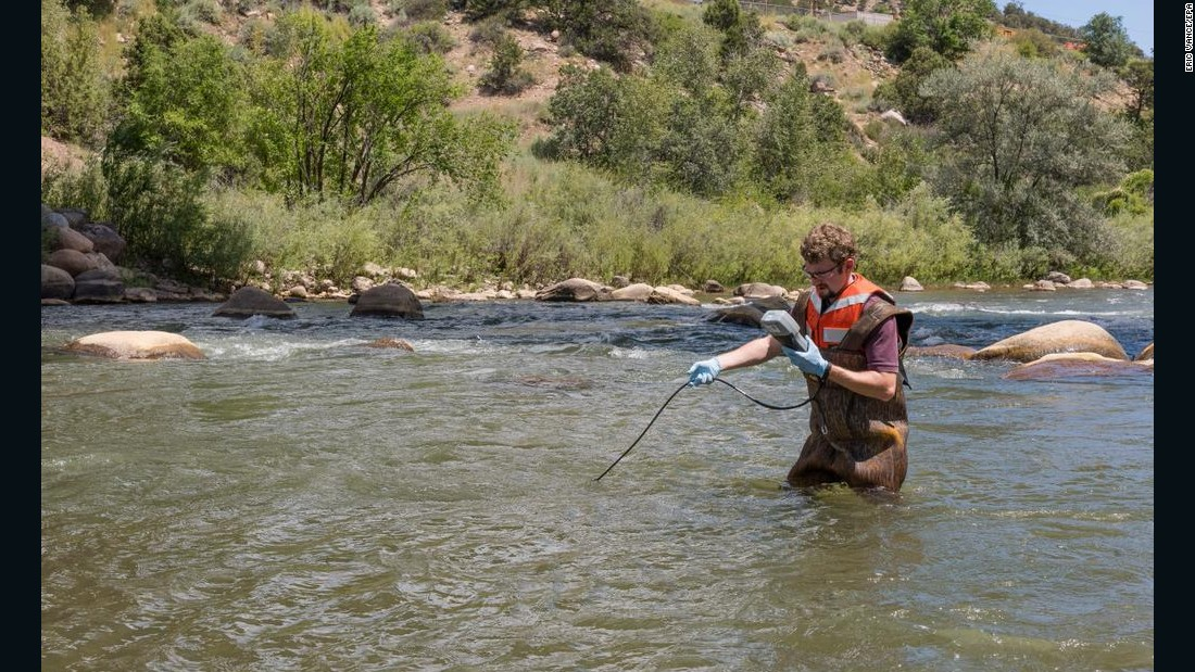 "An EPA worker takes a water reading in the Animas River near Durango, Colorado, on Friday, August 14. <a href=""http://www.cnn.com/2015/08/14/us/animas-river-colorado-epa-mine-spill/index.html"">The river reopened for recreational use Friday afternoon</a> in La Plata County, Colorado, where an EPA crew polluted the waterway with mine waste on August 5, authorities said."