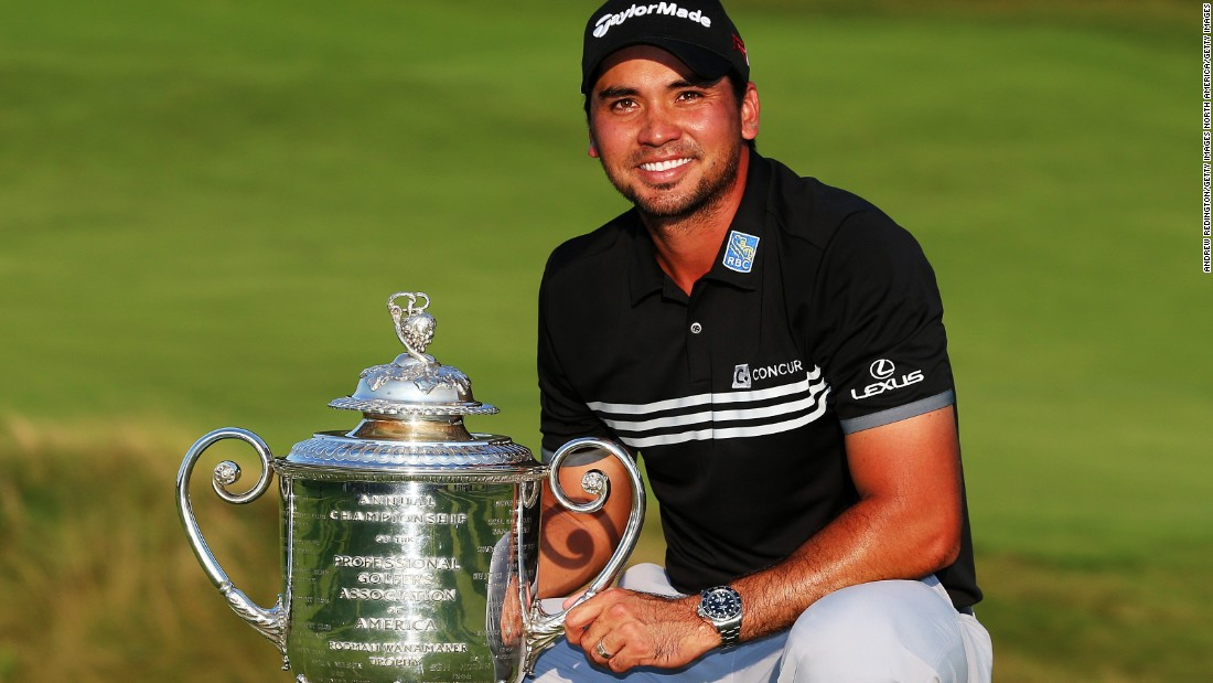 The Australian poses with the Wanamaker trophy after claiming his first major title with a record score of 20 under par.