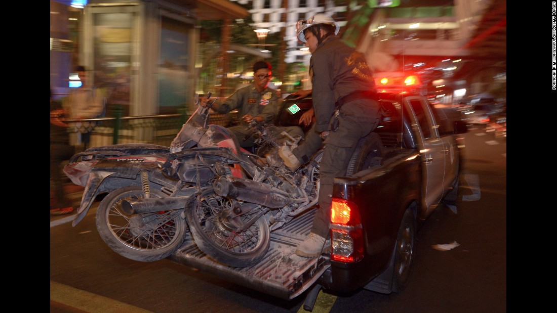 Authorities transport motorcycles destroyed in the blast.