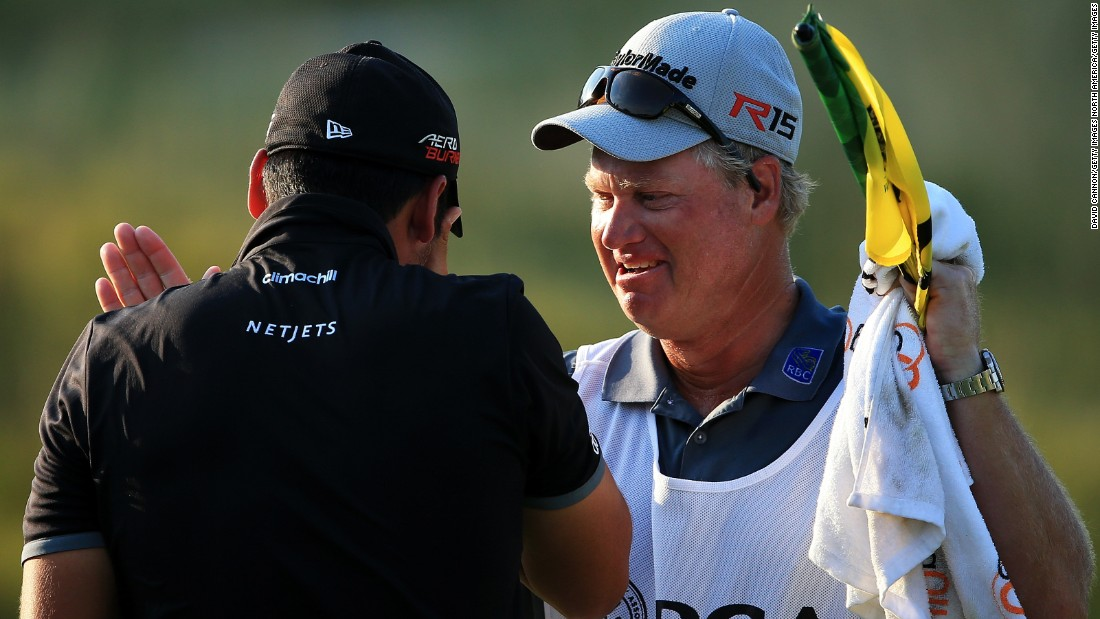 The tearful 27-year-old was congratulated by his longtime caddy and mentor Colin Swatton on the 18th green.