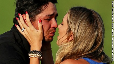 A tearful Jason Day celebrates with his wife Ellie after winning the 2015 PGA Championship.