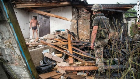 A Ukrainian serviceman examine a destroyed house after shelling between Ukrainian forces and pro-Russian seperatists in the town of Zolote, some 60 km west of Lugansk, on August 16, 2015. Three civilians have been killed in east Ukraine as government forces claimed on August 15 that shelling by pro-Russian separatists hit a record high since the start of a tattered truce in February. AFP PHOTO / OLEKSANDR RATUSHNIAKOLEKSANDR RATUSHNIAK/AFP/Getty Images