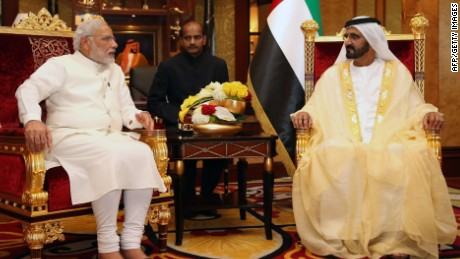 "A picture made available by the United Arab Emirates' official news agency WAM on August 17, 2015 shows Sheikh Mohammed bin Rashid al-Maktoum, Prime Minister of the United Arab Emirates (UAE) and ruler of Dubai shaking hands with Indian Prime Minister Narendra Modi (L) before a meeting in Dubai. Modi is on a two-day visit, the first by an Indian premier in more than three decades, during which he discussed ""cooperation"" with oil-rich UAE. AFP PHOTO / HO / WAM"