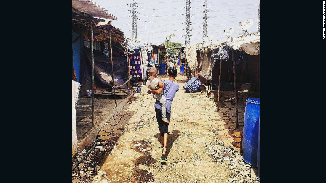 """We had to do an enormous amount of on the ground research to ensure that our features are aligned with the human experience of living in informal settlements,"" said Gluckman. Pictured, a mother and child in Wadala settlement, Mumbai."