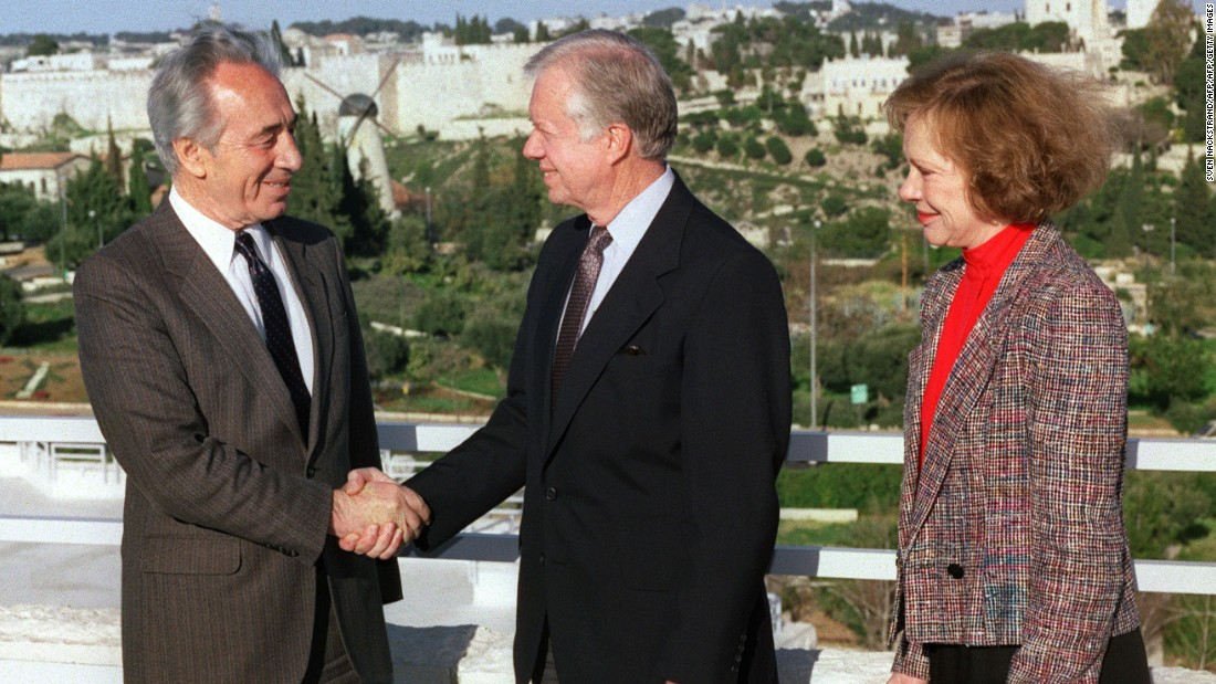 Carter shakes hands with Israeli Labour Party leader Shimon Peres in Jerusalem in March 1990.