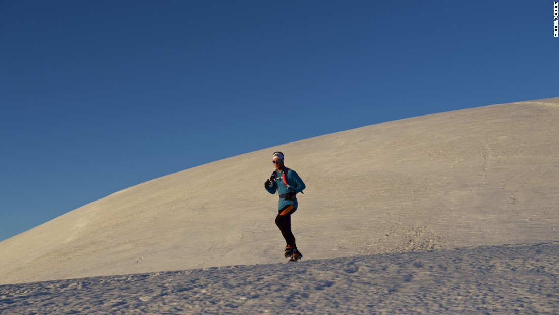 Under clear blue skies, Andreas Steindl begins his mountain challenge.