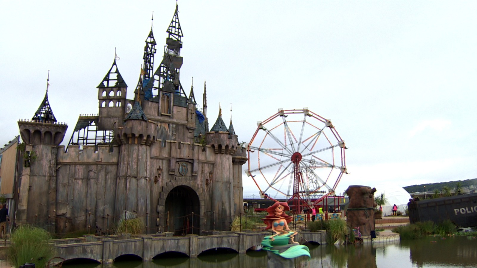Banksy turns Dismaland into migrant shelters