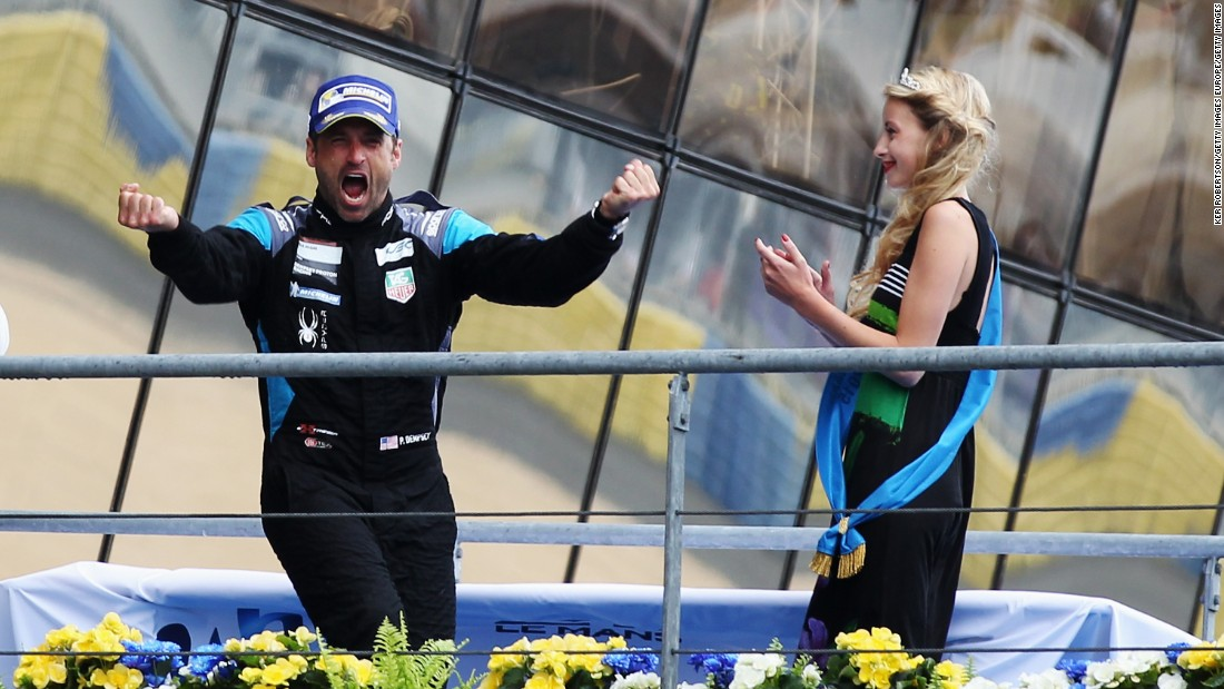 Dempsey celebrates on the podium after finishing second in the GTE Am class during the Le Mans 24 Hour race.