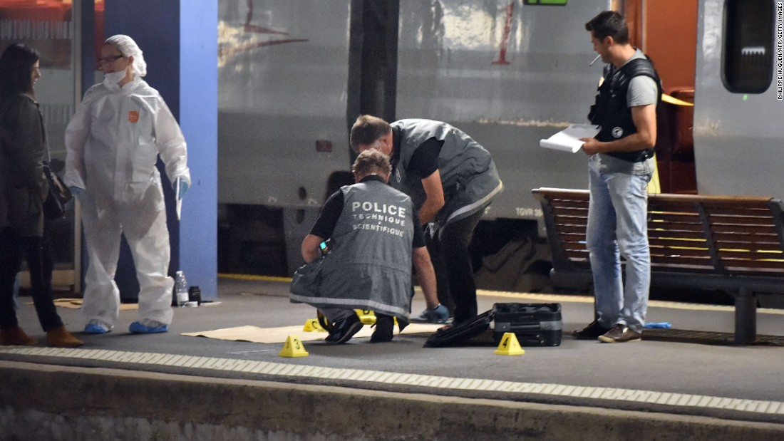 Police work on a platform next to a high-speed train in Arras, France, on Friday, August 21.