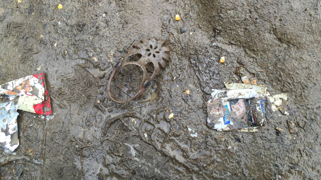 A child's shoe in the mud. Many lose their shoes in the chaos on the border.