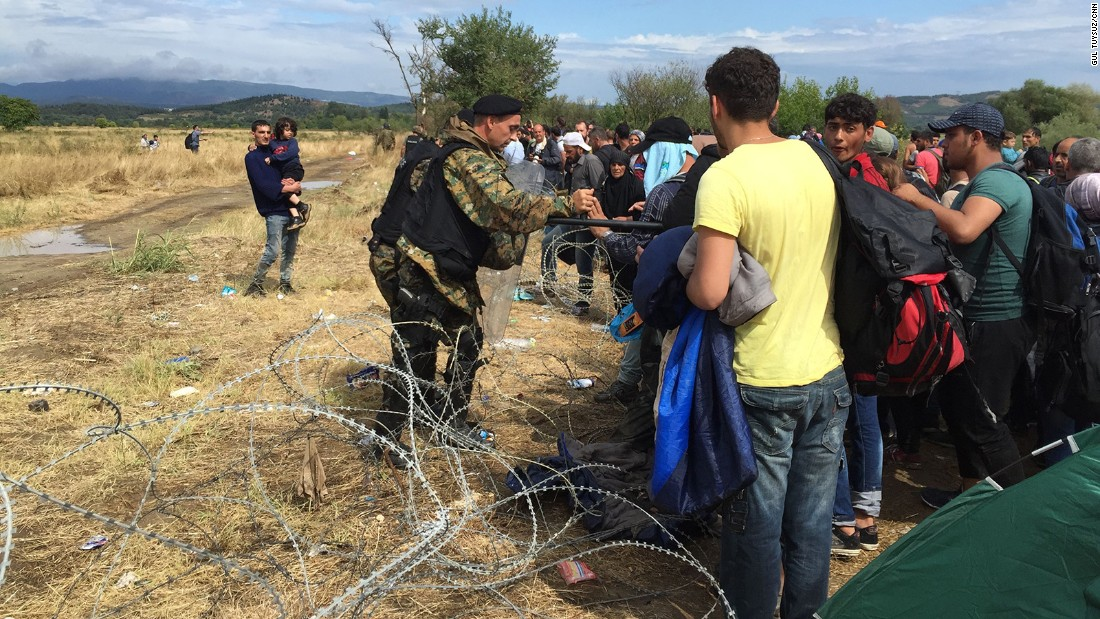 Macedonian border guards as they try to keep migrants from crossing the razor fence.
