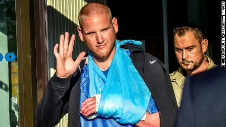 Off-duty US Air Force Spencer Stone (L), one of the men to overpower the gunman who opened fire with an assault rifle on a high-speed train, gestures as he leaves the hospital of Lesquin, northern France on August 22. On August 21, a gunman opened fire on the train traveling from Amsterdam to Paris, injuring two people before being tackled by several passengers including off-duty American servicemen. Spencer Stone was first to the gunman who slashed him in the neck and almost sliced off his thumb with a box-cutter.