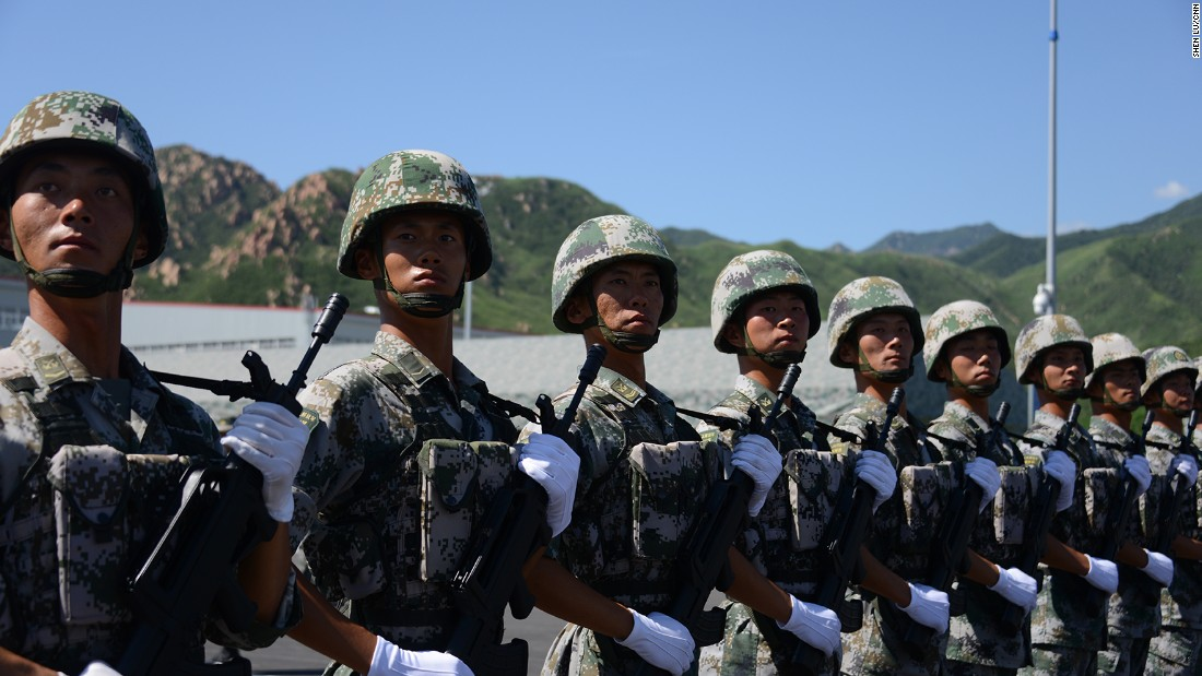 People's Liberation Army soldiers stand to attention in their combat fatigues on August 22.