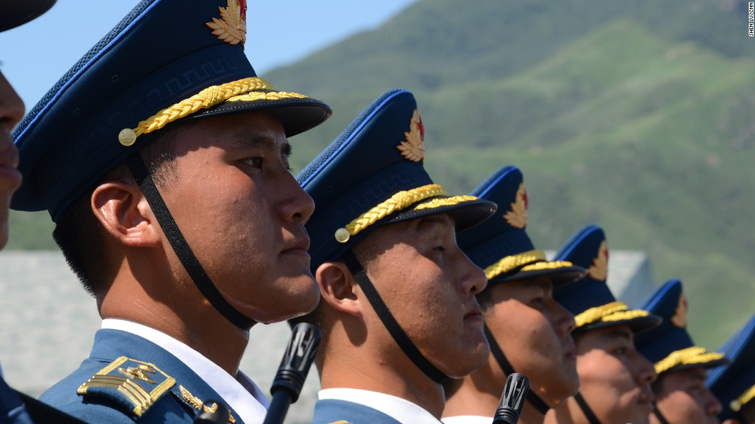 Soldiers line up during the large-scale rehearsal. Every soldier will have to stand still for up to two hours without changing form.
