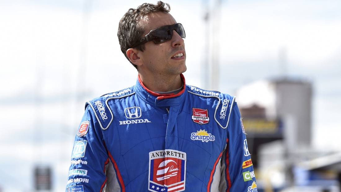 Justin Wilson, of England, walks on pit road during qualifying for Sunday's Pocono IndyCar 500 auto race, Saturday, Aug. 22,, in Long Pond, Pa. Wilson was injured during Sunday's race and air lifted to the hospital.