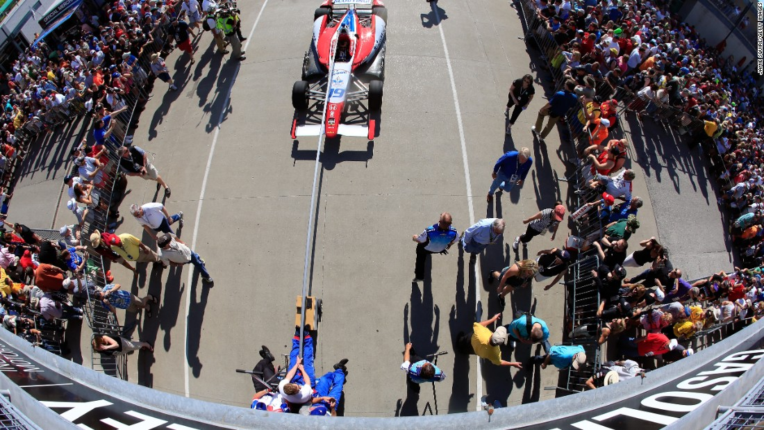 Crew members pull Wilson's car onto the grid before the Indianapolis 500 in May.