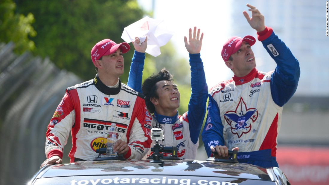 Wilson, right, rides a parade lap with Graham Rahal and Takuma Sato after finishing third in a race in April 2013.