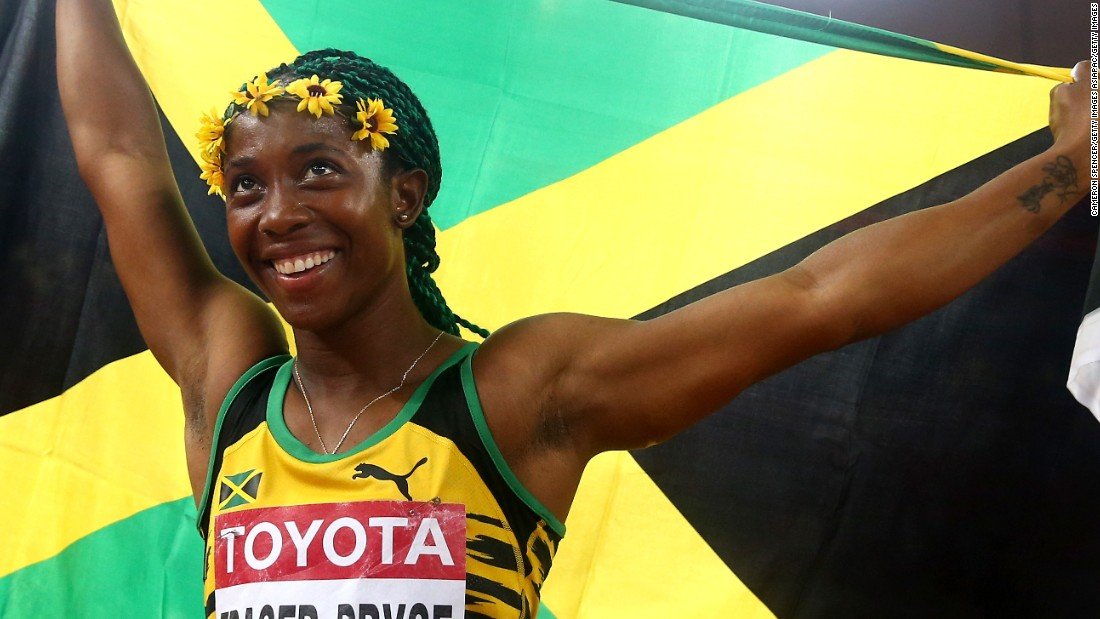Shelly-Ann Fraser-Pryce celebrates after winning gold in the women's 100 meters final in Beijing.