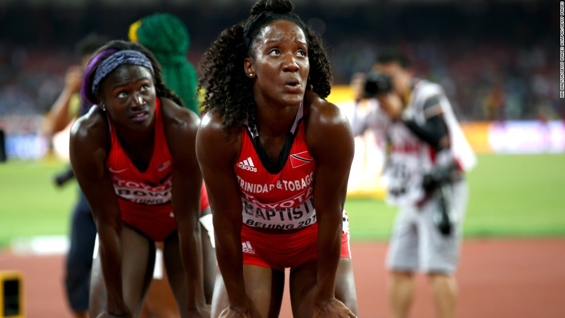 American runner Tori Bowie (left) won bronze. Here she looks at the video screen after the race along with Kelly-Ann Baptiste of Trinidad and Tobago, who was sixth.