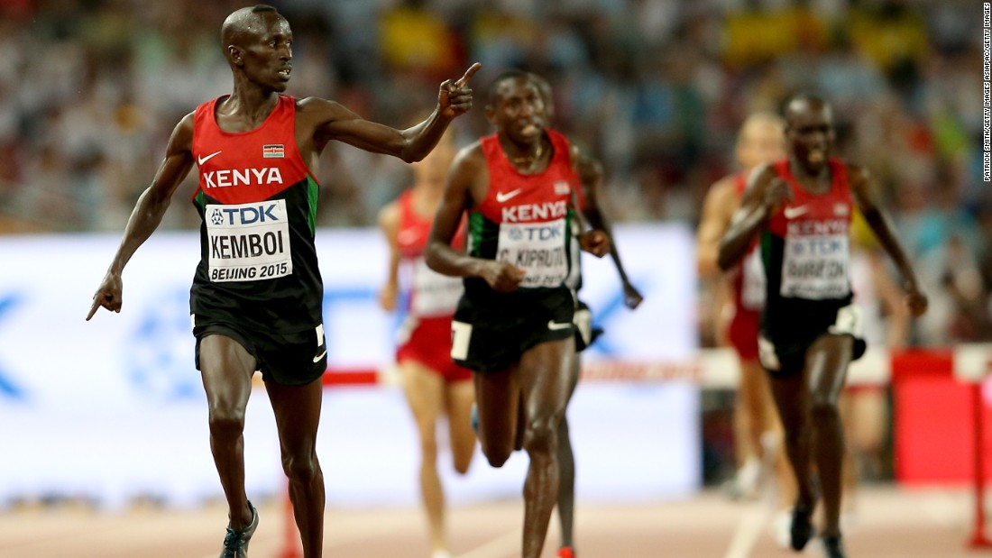 Ezekiel Kemboi celebrates his fourth successive men's 3,000m steeplechase title, as Kenyan runners took the first four places.