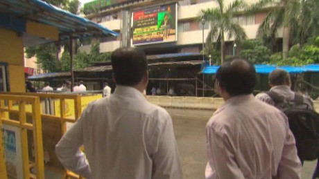 Watching the stock ticker in Mumbai