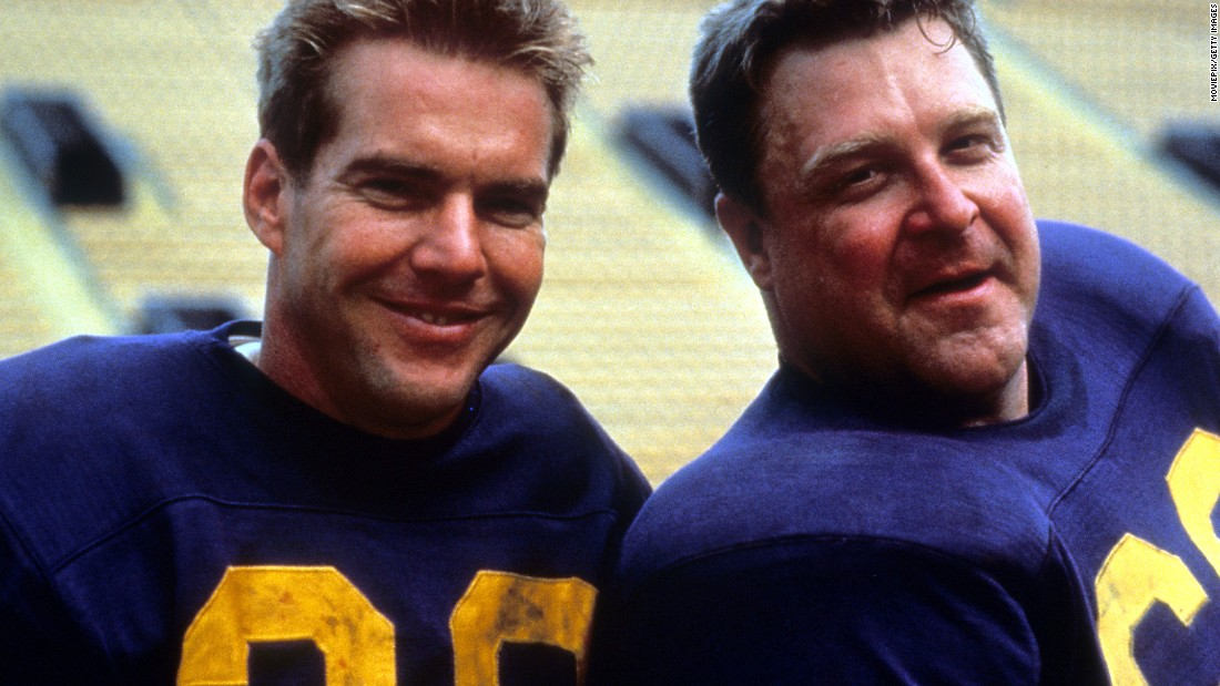 "Dennis Quaid and John Goodman ham it up in the 1988 movie ""Everybody's All-American."""