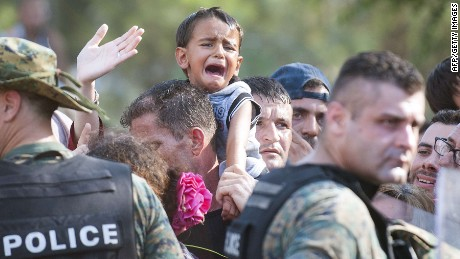 "A young boy cries as police block a group of migrants trying to cross the Macedonian-Greek border near the town of Gevgelija on August 21, 2015. Macedonia said on August 20 that it had declared a ""state of emergency"" on its southern border with Greece and would draft in the army to help control the influx of migrants crossing the frontier. AFP PHOTO / ROBERT ATANASOVSKIROBERT ATANASOVSKI/AFP/Getty Images"
