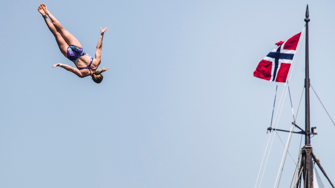 Rachelle Simpson of the USA dives from the 20 metre during the first rounds of the fourth stop of the Red Bull Cliff Diving World Series, Kragero, Norway on July 11th 2014.